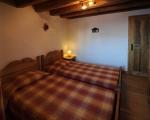Schlafzimmer2-La-grange-24-Miethauschen-apartments-savoie-menuires